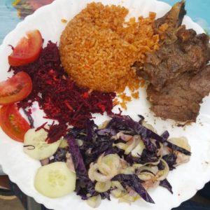 goat and rice dish, gambian food served at casablanca morro restaurant